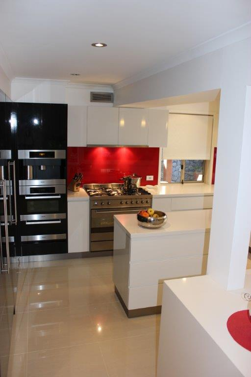 Kitchens-Renovations-Brisbane-Crisp-White-Bench-Top-with-Red-Splashback