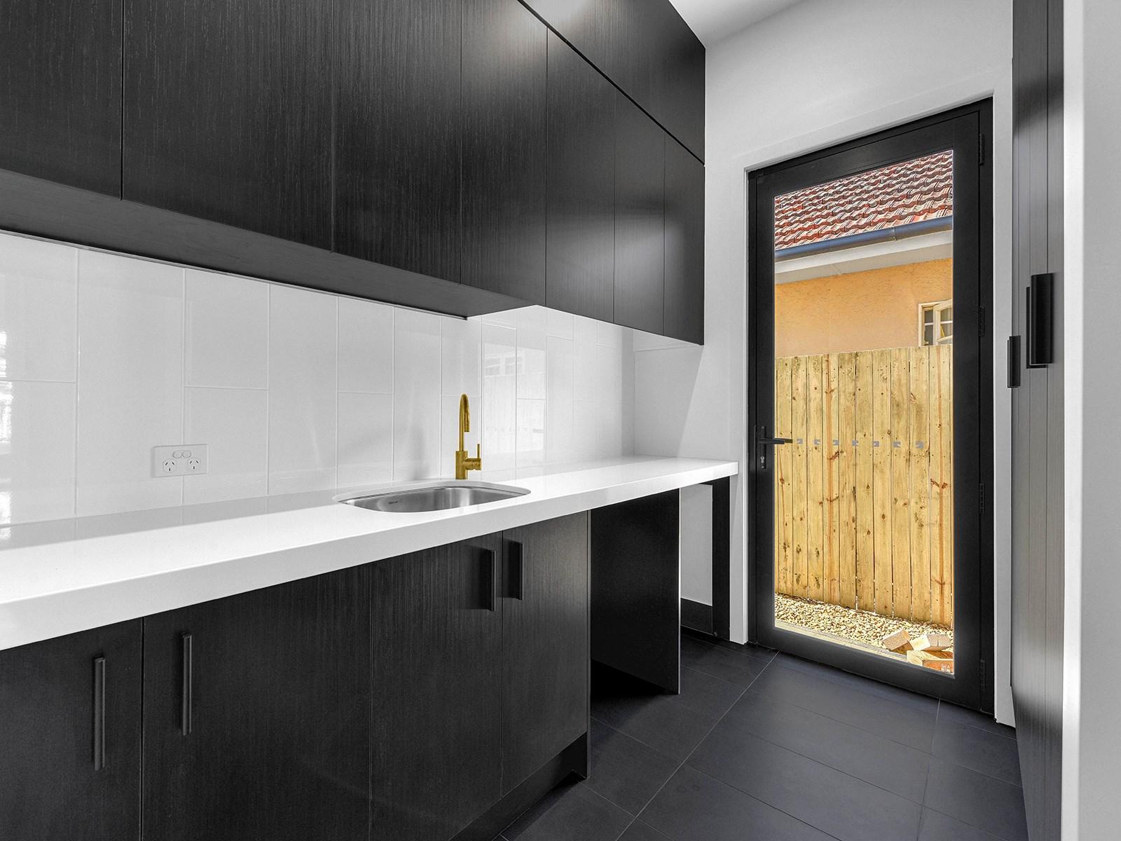 Laundry-Brisbane-white-benchtops-tiled-splashback